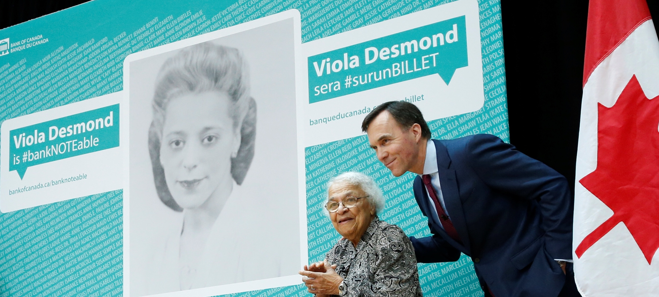 Canada's Finance Minister Bill Morneau stands with Wanda Robson after her sister Viola Desmond was chosen to be featured on a new $10 bank note during a ceremony at the Museum of History in Gatineau, Quebec, Canada, December 8, 2016. REUTERS/Chris Wattie - RC1AA8CBDF00