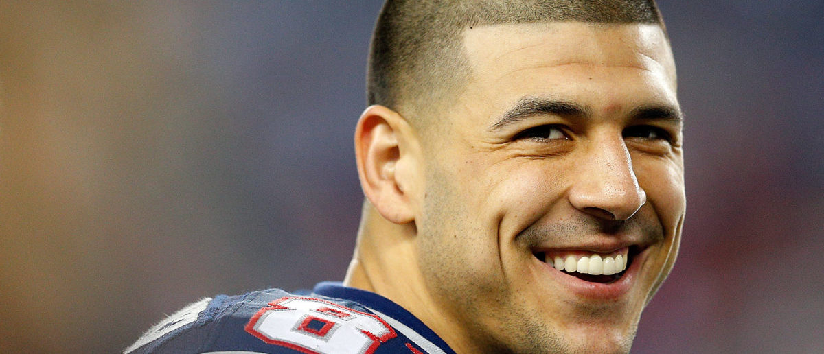 FOXBORO, MA - DECEMBER 10: Aaron Hernandez #81 of the New England Patriots smiles from the sidelines in the fourth quarter during a game against the Houston Texans at Gillette Stadium on December 10, 2012 in Foxboro, Massachusetts. (Photo by Jim Rogash/Getty Images)