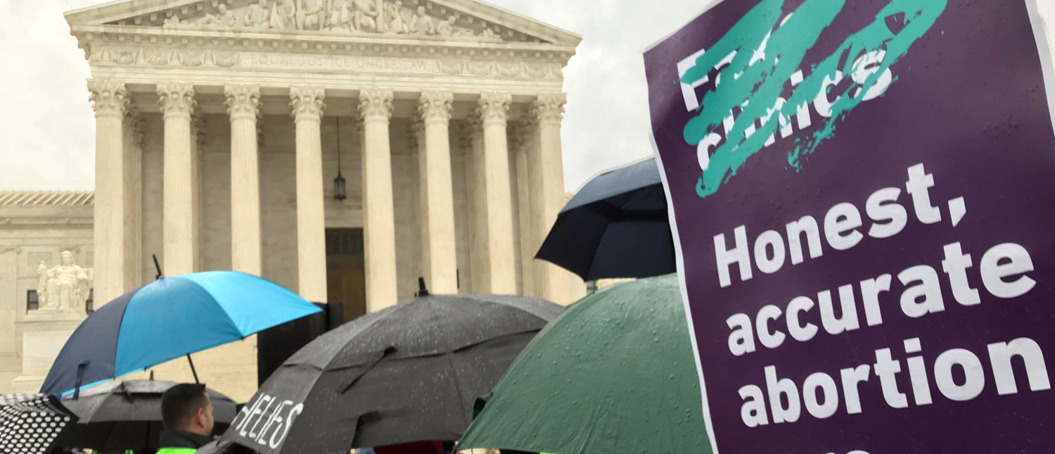 Supporters of a California law, requiring anti-abortion pregnancy centers to post signs notifying women of the availability of state-funded contraception and abortion, hold a rally in front of the U.S. Supreme Court in Washington, U.S., March 20, 2018. REUTERS/Andrew Chung