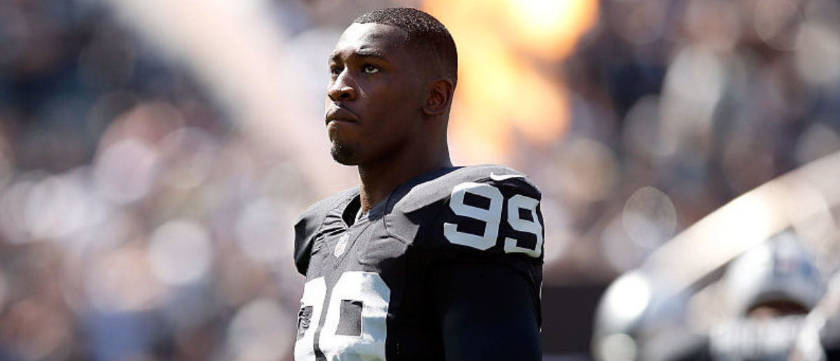 OAKLAND, CA - SEPTEMBER 20: Aldon Smith #99 of the Oakland Raiders stands on the field before their game against the Baltimore Ravens at O.co Coliseum on September 20, 2015 in Oakland, California. (Photo by Ezra Shaw/Getty Images)