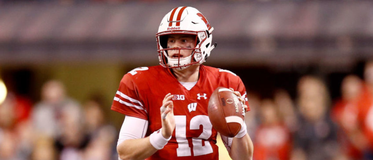 INDIANAPOLIS, IN - DECEMBER 02: Alex Hornibrook #12 of the Wisconsin Badgers looks to throw a pass against the Ohio State Buckeyes in the Big Ten Championship at Lucas Oil Stadium on December 2, 2017 in Indianapolis, Indiana. (Photo by Andy Lyons/Getty Images)
