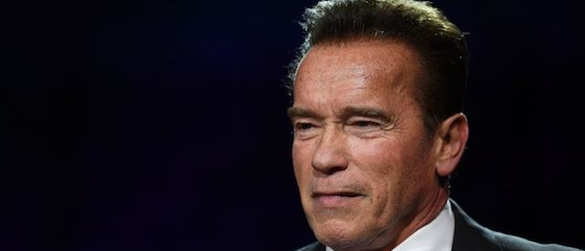 """Former Governor of California and US actor Arnold Schwarzenegger speaks during a panel conference at the One Planet Summit on December 12, 2017, at La Seine Musicale venue on l'ile Seguin in Boulogne-Billancourt, west of Paris. ?The French President hosts 50 world leaders for the """"One Planet Summit"""", hoping to jump-start the transition to a greener economy two years after the historic Paris agreement to limit climate change. / AFP PHOTO / Eric FEFERBERG (Photo credit should read ERIC FEFERBERG/AFP/Getty Images)"""