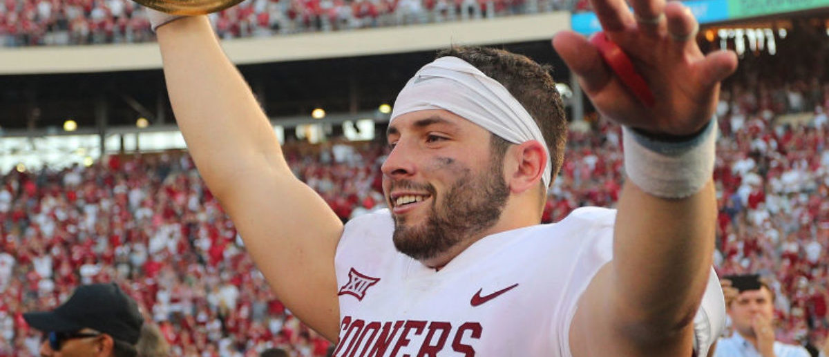 DALLAS, TX - OCTOBER 14: Baker Mayfield #6 of the Oklahoma Sooners waves the Golden Hat Trophy after the 29-24 win over the Texas Longhorns at Cotton Bowl on October 14, 2017 in Dallas, Texas. (Photo by Richard W. Rodriguez/Getty Images)
