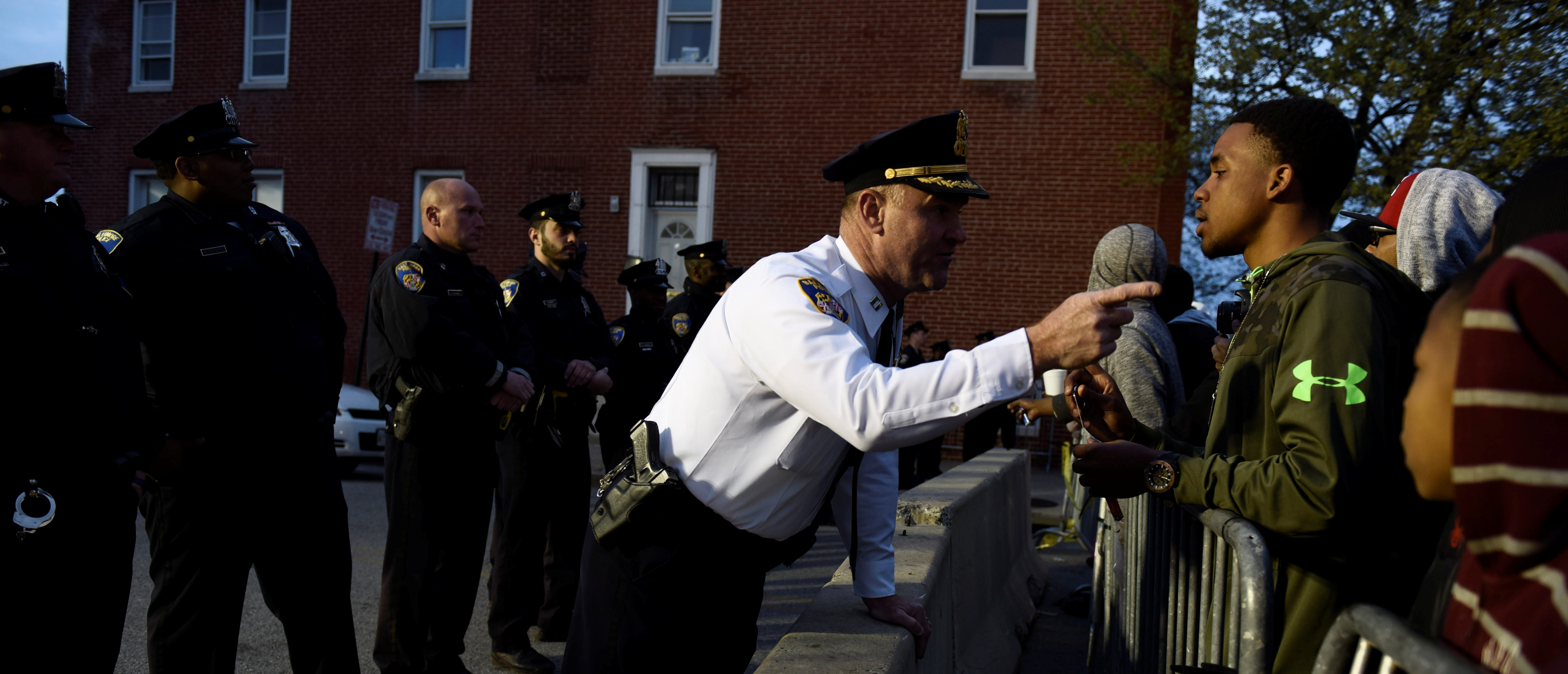 QUALITY REPEATCaptain Erik Pecha of the Baltimore Police Department chats with a young demonstrator in front of the Baltimore Police Department Western District station during a protest against the death in police custody of Freddie Gray in Baltimore April 23, 2015. The U.S. Southern Christian Leadership Conference will independently investigate the death of a black Baltimore man in police custody, with the local head of the civil rights group saying it lacked confidence in a police probe into the death. REUTERS/Sait Serkan Gurbuz - S1BEUBLGZNAA