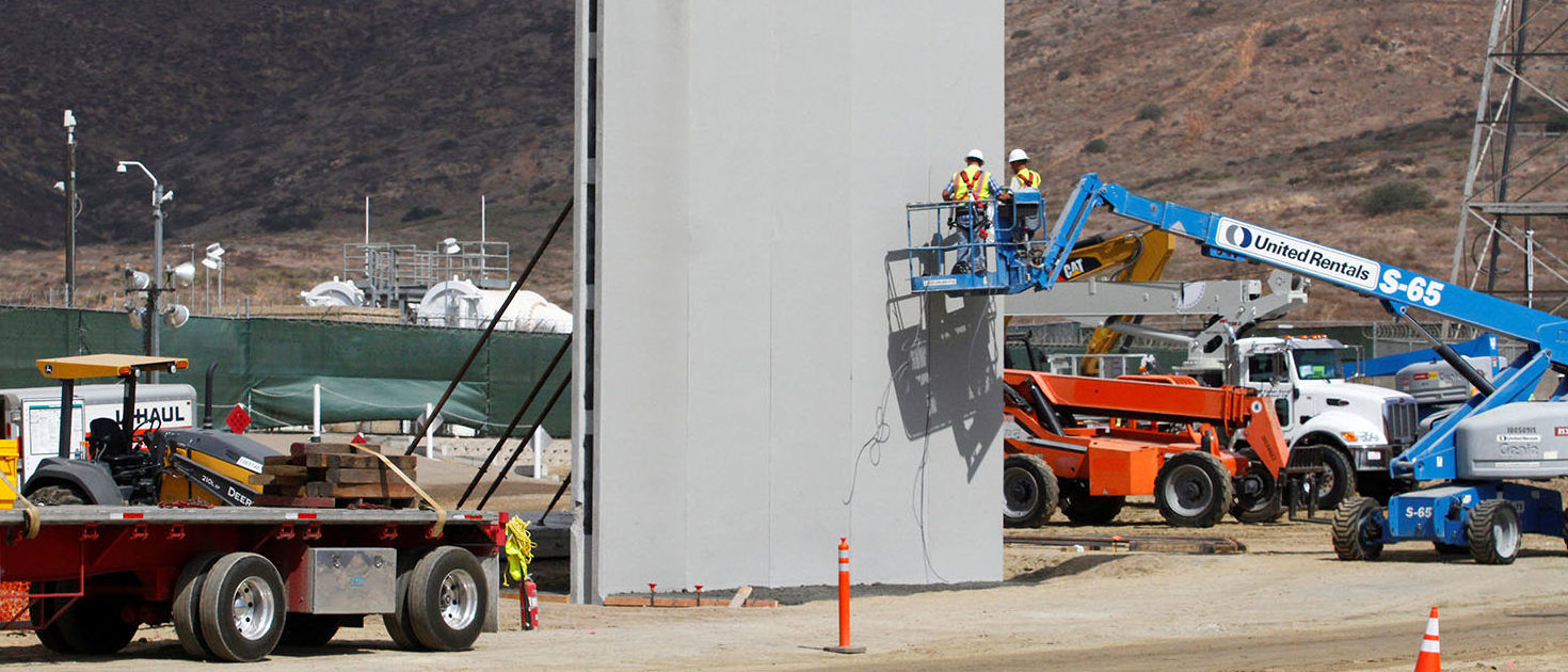 People work in San Diego, California, U.S., at the construction site of prototypes for U.S. President Donald Trump's border wall with Mexico, in this picture taken from the Mexican side of the border in Tijuana, Mexico October 3, 2017.  REUTERS/Jorge Duenes