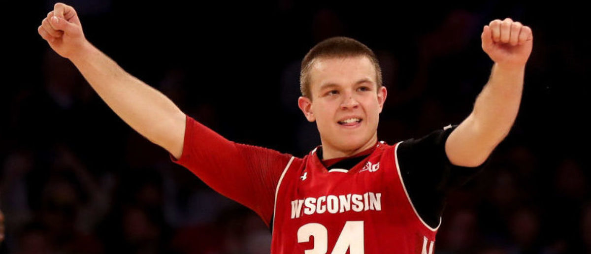 NEW YORK, NY - MARCH 01: Brad Davison #34 of the Wisconsin Badgers celebrates the win over the Maryland Terrapins during the second round of the Big Ten Basketball Tournament at Madison Square Garden on March 1, 2018 in New York City. (Photo by Elsa/Getty Images)