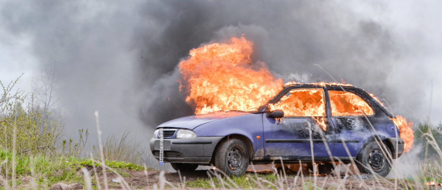 Burning and crashed car after an explosion. [Shutterstock - LaineN]