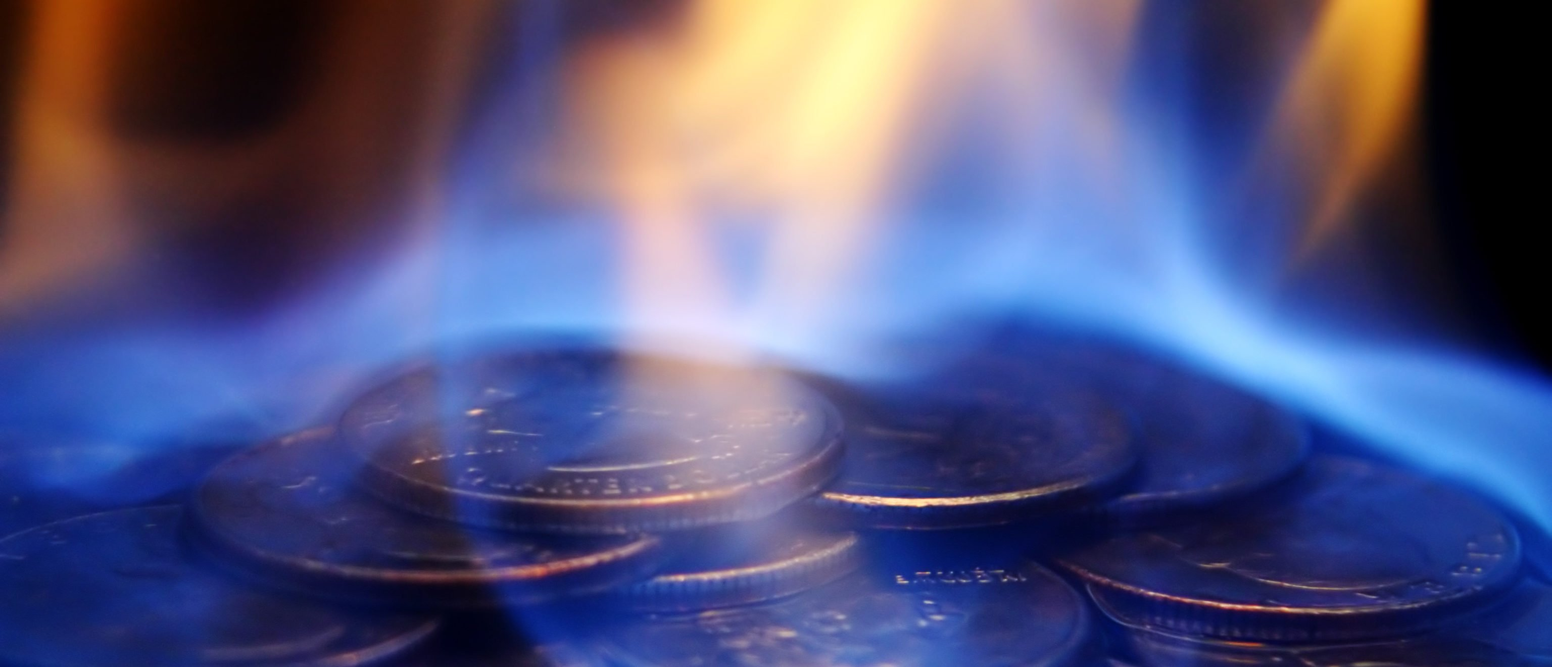 A burning pile of quarters. (Shutterstock)