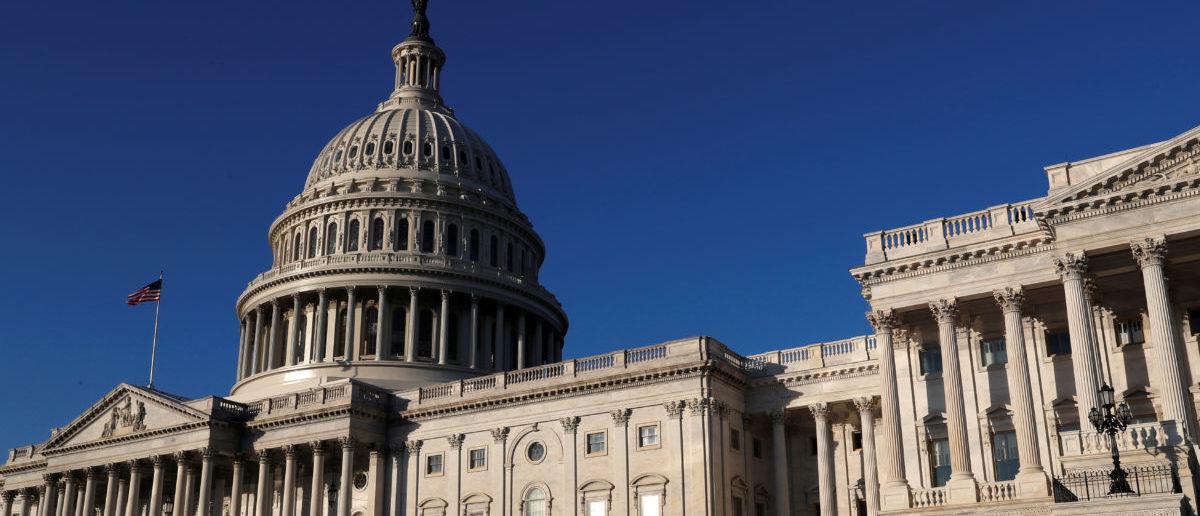 People walk by the U.S. Capitol building in Washington, U.S., February 8, 2018. REUTERS/ Leah Millis