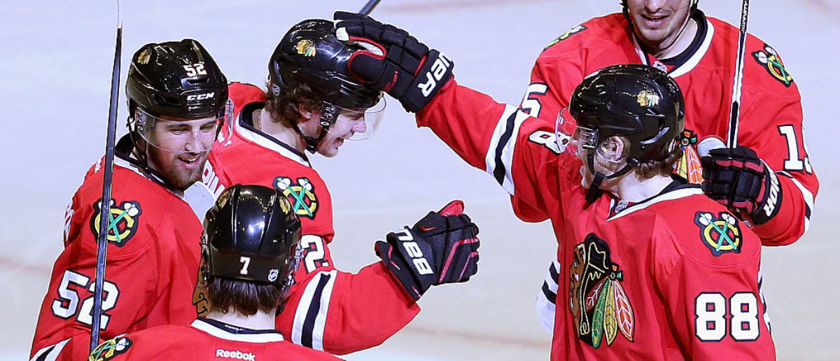 CHICAGO, IL - JANUARY 06: (L-R) Brent Seabrook #7, Erik Gustafsson #52, Artemi Panarin #72, Artem Anisimov #15 and Patrick Kane #88 congratulate Panarin after his second goal of the game against the Pittsburgh Penguins in the third period at the United Center on January 6, 2016 in Chicago, Illinois. The Blackhawks defeated the Penguins 3-1. (Photo by Jonathan Daniel/Getty Images)