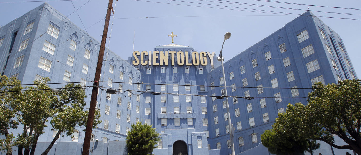People walk past the Church of Scientology of Los Angeles building in Los Angeles, California July 3, 2012.  REUTERS/Mario Anzuoni  | Worldwide Cult Gets Its Own TV Network