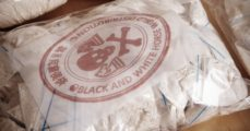 Hundred of drug bags. (Couperfield/Shutterstock) | Illegal Immigrants Found Smuggling Heroin