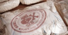 Hundred of drug bags. (Couperfield/Shutterstock) | Woman Busted Flying 15 Pounds Of Heroin