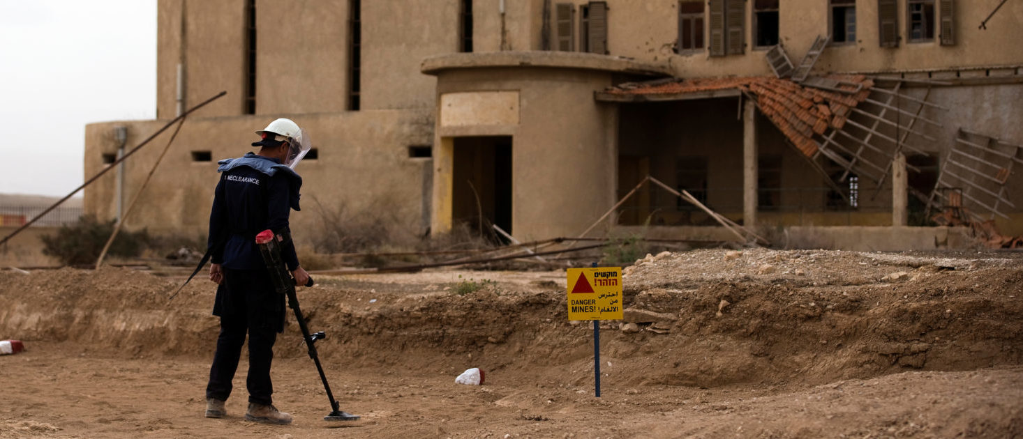 A sapper belonging to the HALO Trust, an international landmine clearance charity, looks for old mines in an abandoned church property complex near Qasr Al-Yahud, a traditional baptism site along the Jordan River, near Jericho in the occupied West Bank, March 29, 2018. REUTERS/Ronen Zvulun