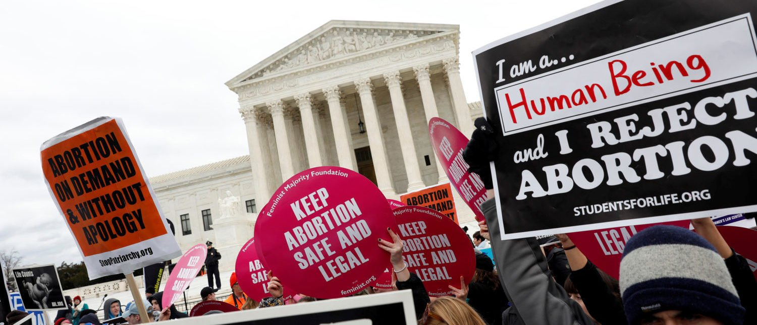 Pro-life and pro-choice activists gather at the Supreme Court for the National March for Life rally in Washington January 27, 2017. REUTERS/Aaron P. Bernstein