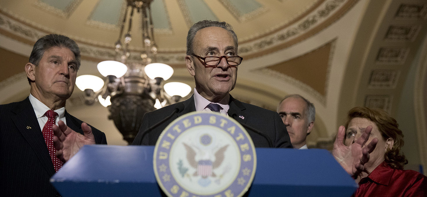 Senate Minority Leader Chuck Schumer, flanked by Sen. Joe Manchin (D-WV), Sen. Bob Casey (D-PA) and Sen. Heidi Heitkamp (D-ND), speaks to the media after the weekly policy luncheon on Capitol Hill May 2, 2017 in Washington, DC. Democrats discussed the recent spending bill that averted a government shutdown. (Photo by Aaron P. Bernstein/Getty Images)