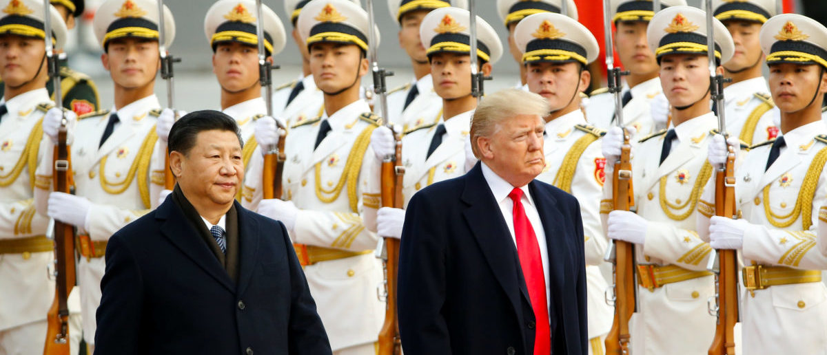 U.S. President Donald Trump takes part in a welcoming ceremony with China's President Xi Jinping in Beijing, China, November 9, 2017. REUTERS/Thomas Peter