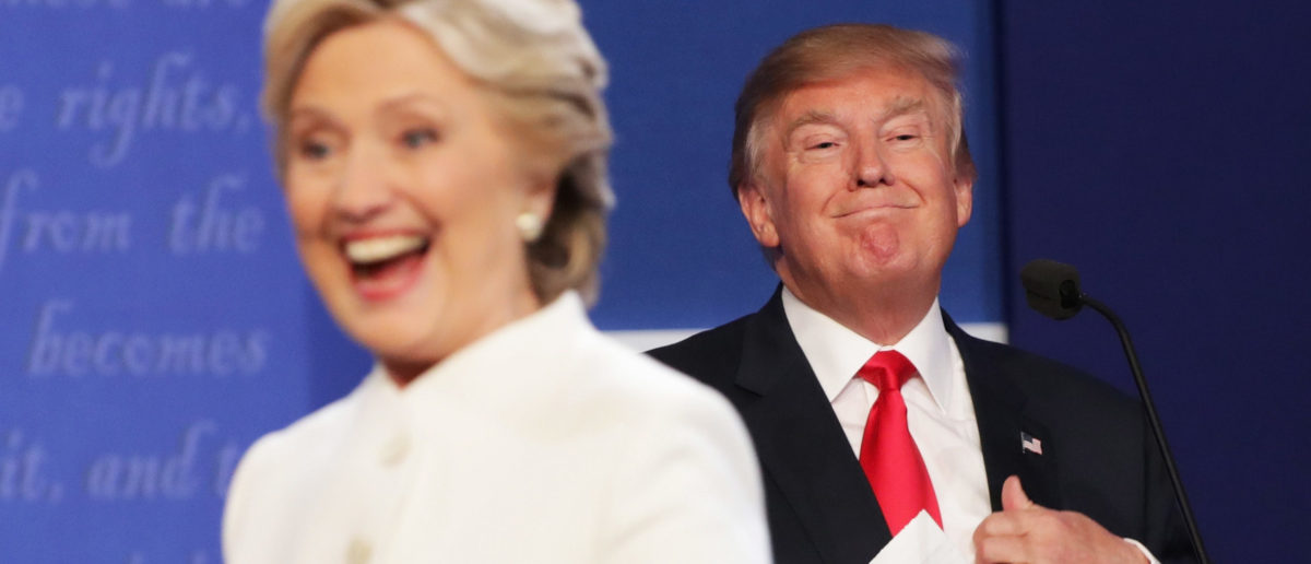 Hillary Clinton walks off stage as Donald Trump smiles after the debate in Las Vegas. Chip Somodevilla/Getty Images.