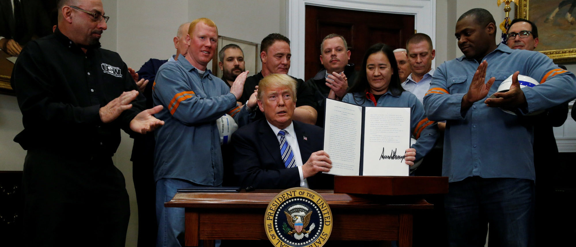 President Donald Trump is after signing a proclamation to establish tariffs on imports of steel and aluminum at the White House in Washington, March 8, 2018. REUTERS/Leah Millis