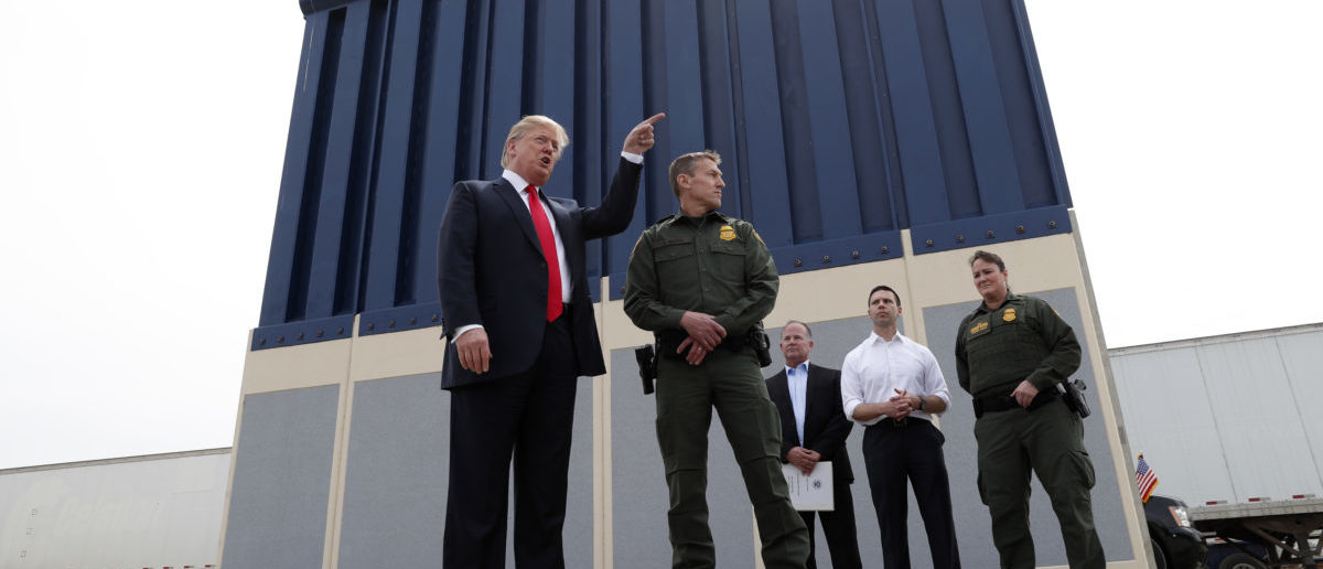 U.S. President Donald Trump talks with a U.S. Customs and Border Protection (CBP) Border Patrol Agent while participating in a tour of U.S.-Mexico border wall prototypes near the Otay Mesa Port of Entry in San Diego, California. U.S., March 13, 2018. REUTERS/Kevin Lamarque | Enviros Launch Another Lawsuit Over Wall