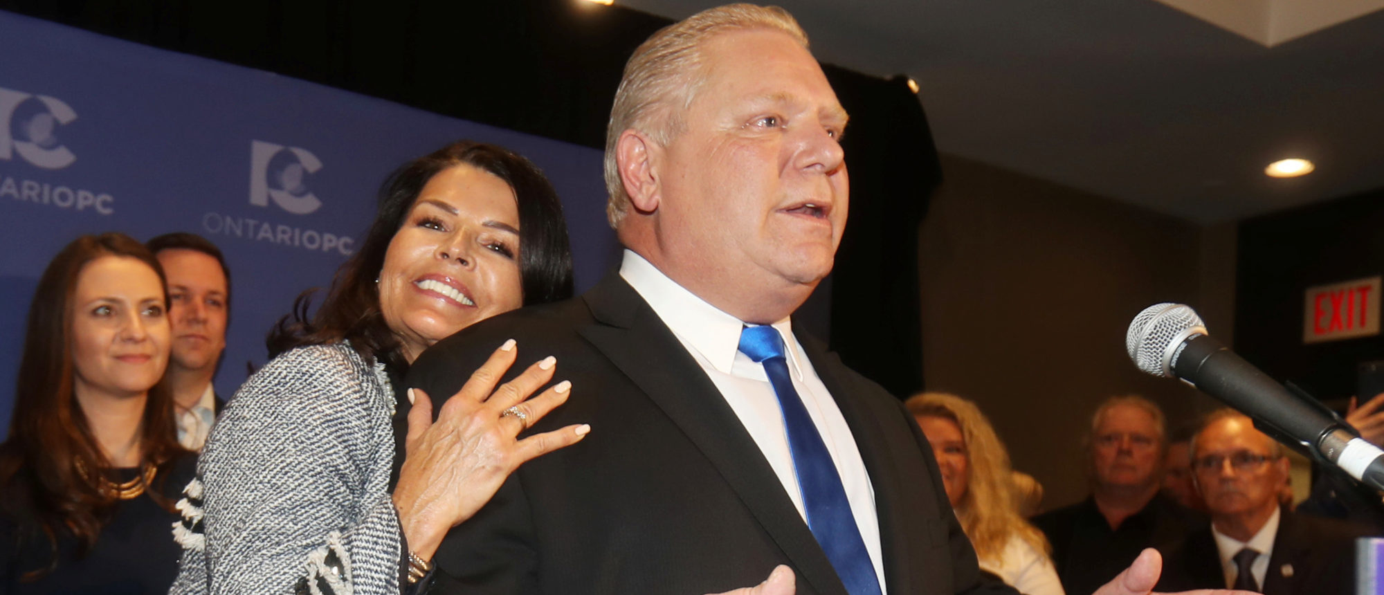 Progressive Conservatives leadership race winner Doug Ford speaks with his wife Karla in Markham, Ontario, Canada, March 10, 2018. REUTERS/Fred Thornhill