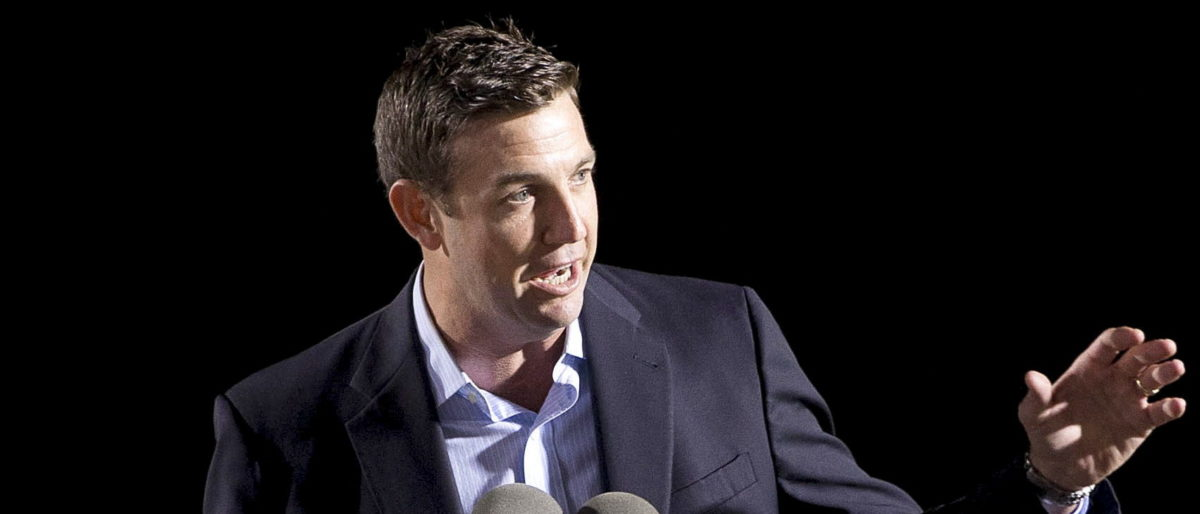 U.S. Congressman Duncan D. Hunter (R-CA) speaks at the launch of the Isla Bella, the first container ship to be powered by liquid natural gas, during a nighttime ceremony at General Dynamics NASSCO shipyard in San Diego, California April 18, 2015. The 764-foot Marlin-class containership was built for the transportation and logistics company TOTE.  REUTERS/Earnie Grafton