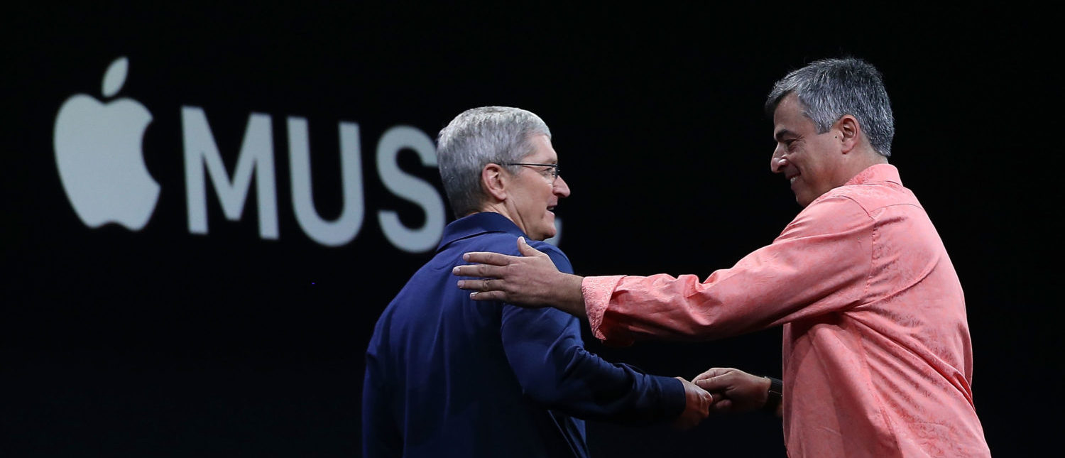 SAN FRANCISCO, CA - JUNE 08: Apple's senior vice president of Internet Software and Services Eddy Cue (R) greets Apple CEO Tim Cook (L) during the Apple WWDC on June 8, 2015 in San Francisco, California. Apple annouced a new OS X, El Capitan, iOS 9 and Apple Music during the keynote at the annual developers conference that runs through June 12. (Photo by Justin Sullivan/Getty Images)