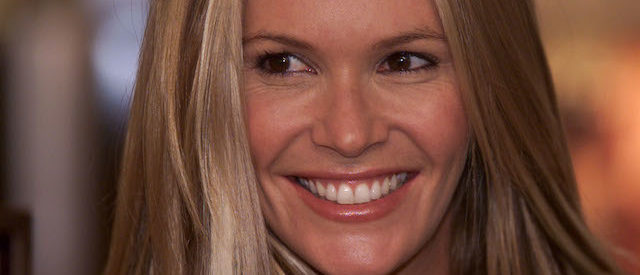 """Australian supermodel Elle Macpherson smiles during a photocall in central London October 3, 2001. MacPherson launched her new lingerie range """"Intimates"""" at Selfridges department earlier today. REUTERS/Stephen Hird PS/AS - RP2DRIOOFAAA"""