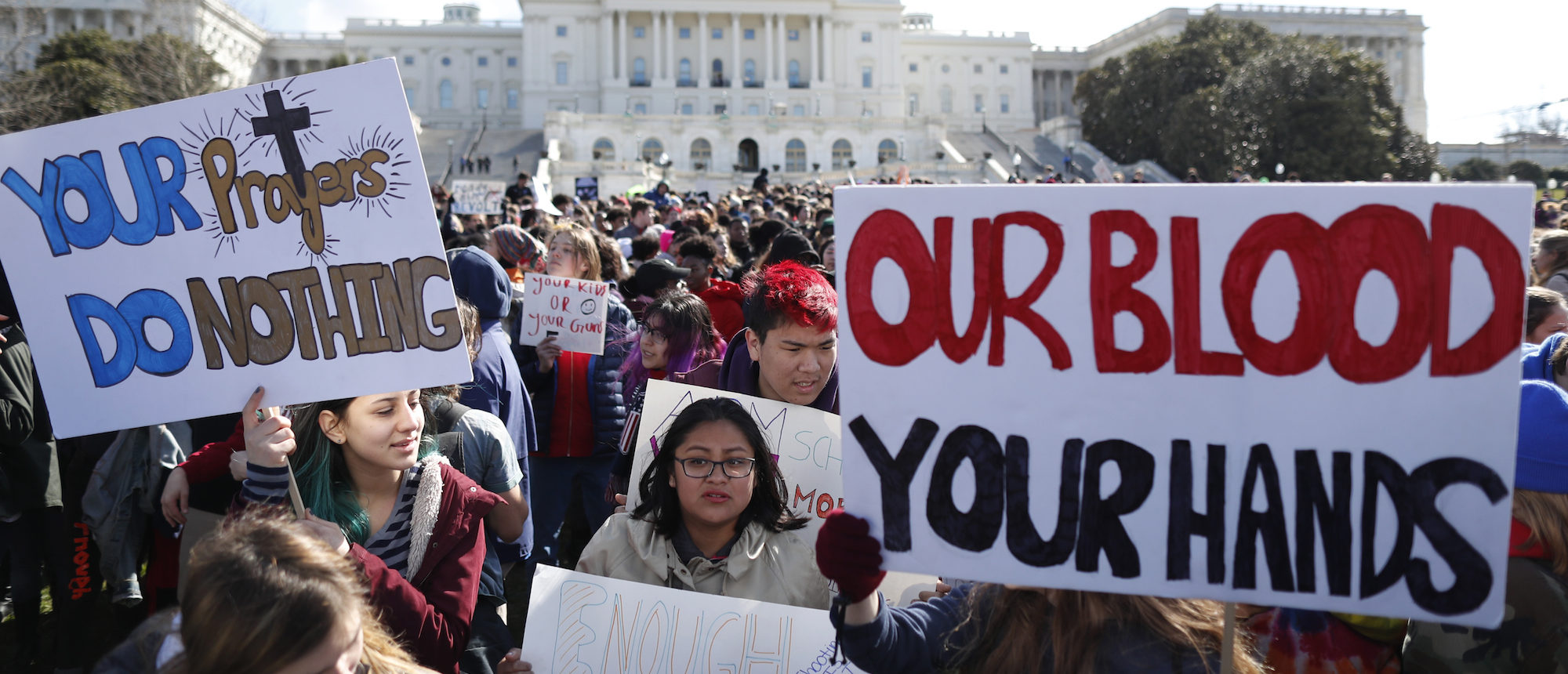 Washington, DC-area students walk out of classes to demand stricter gun laws outside the U.S. Capitol in Washington, March 14, 2018. REUTERS/Jim Bourg