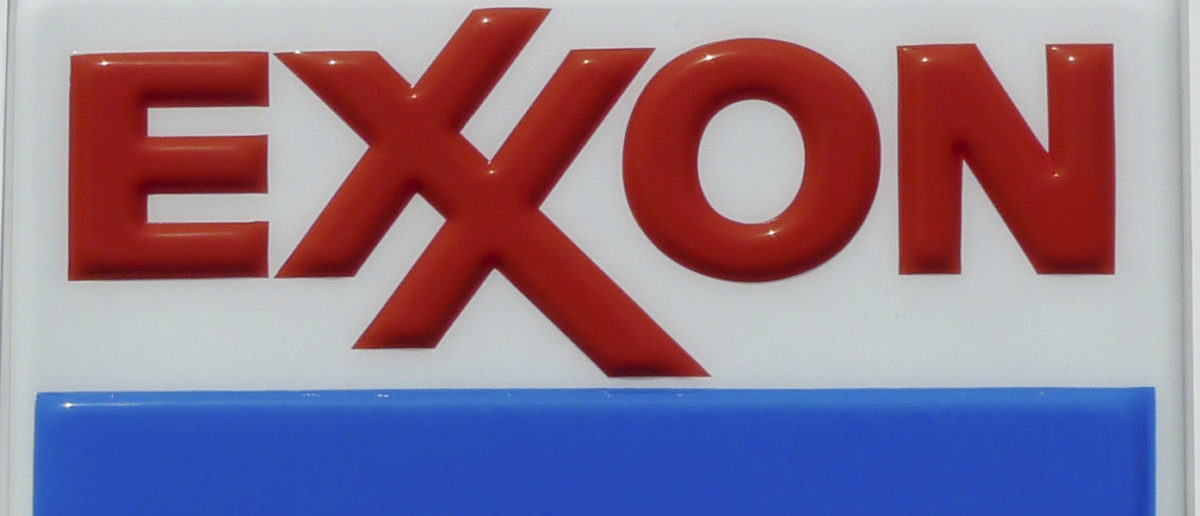 The Exxon corporate logo is pictured at one of the company's gas stations in Arlington
