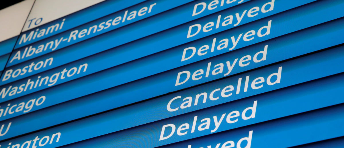 The information board shows cancelled and delayed Amtrak trains at Penn Station during a winter nor'easter in New York