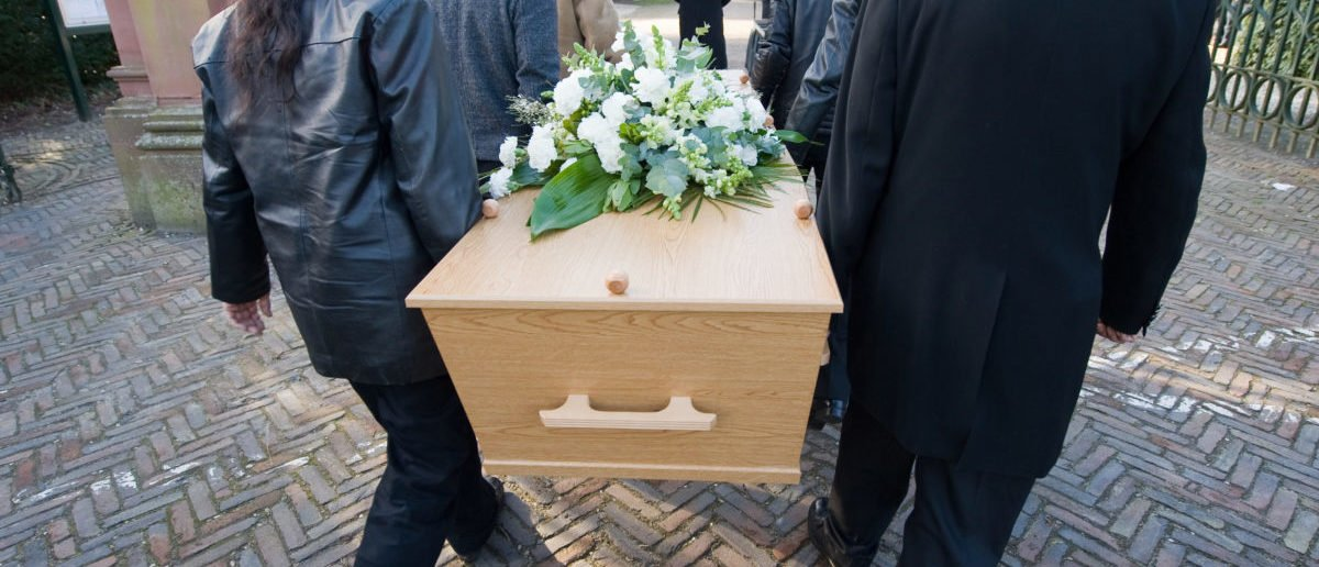 A Illinois county might create a special task force to protect cemeteries as gangs have taken to opening fire on each other during funerals. (Robert Hoetink/Shutterstock)