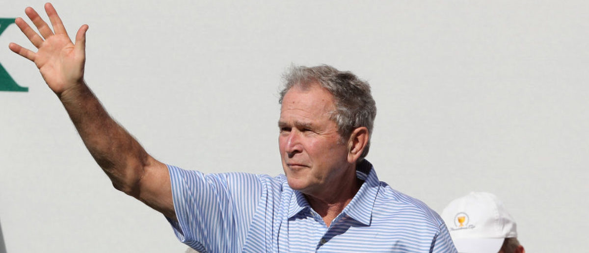 JERSEY CITY, NJ - SEPTEMBER 28: Former U.S. President George W. Bush waves to the crowd prior to Thursday foursome matches of the Presidents Cup at Liberty National Golf Club on September 28, 2017 in Jersey City, New Jersey. (Photo by Sam Greenwood/Getty Images)