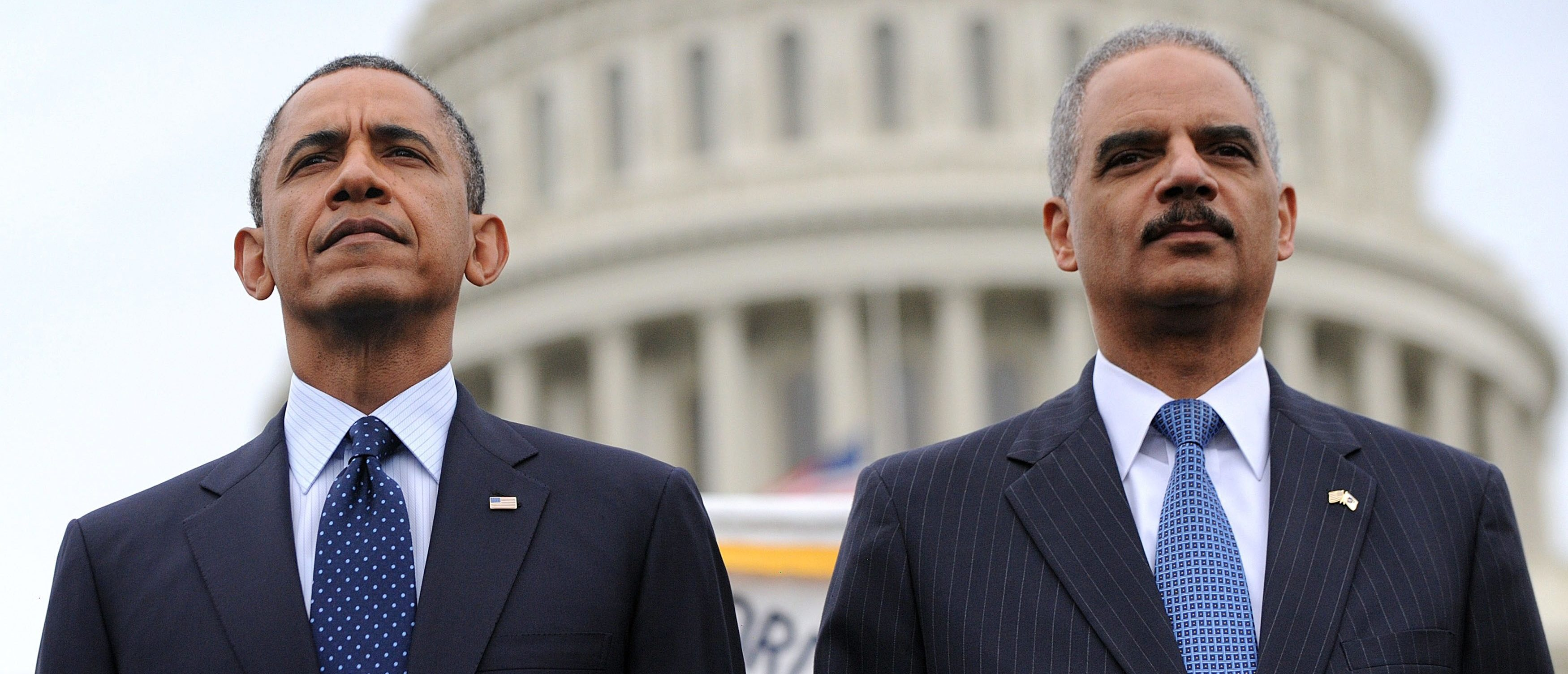 WASHINGTON, DC - MAY 15: (AFP OUT) U.S. President Barack Obama (L) and Attorney General Eric Holder attend the 32nd annual National Peace Officers' Memorial Service at the West Front Lawn at the U.S. Capitol May 15, 2013 in Washington, DC. President Barack Obama delivered remarks at the event, invoking the law enforcement officers who worked to bring the Boston Marathon bombing suspects to justice. (Photo by Olivier Douliery - Pool/Getty Images)