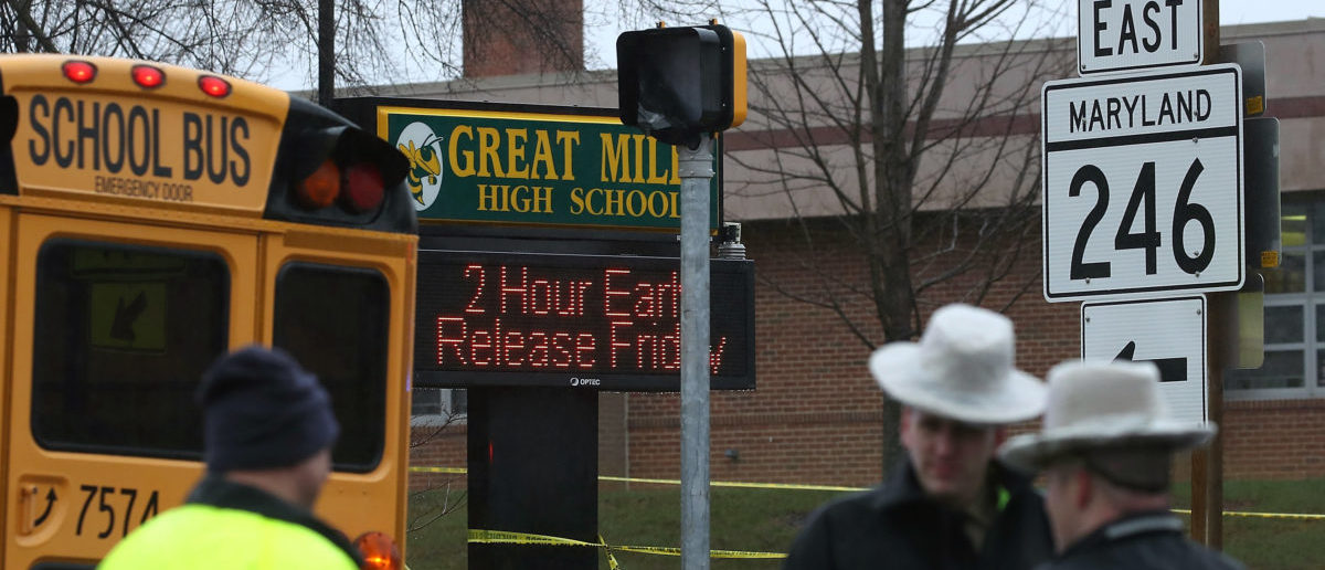 GREAT MILLS, MD - MARCH 20: Police stand in front of Great Mills High School after a shooting on March 20, 2018 in Great Mills, Maryland. It was reported that  two students at a Maryland high school were injured after a colleague opened fire in the hallway just before classes began. (Photo by Mark Wilson/Getty Images)
