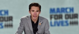 Marjory Stoneman Douglas High School student David Hogg speaks during the March for Our Lives Rally in Washington, DC on March 24, 2018.  Galvanized by a massacre at a Florida high school, hundreds of thousands of Americans are expected to take to the streets in cities across the United States on Saturday in the biggest protest for gun control in a generation. / AFP PHOTO / Nicholas Kamm        (Photo credit should read NICHOLAS KAMM/AFP/Getty Images)