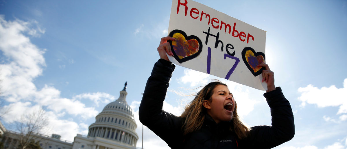 Students from Washington, DC-area schools protest for stricter gun control during a walkout by students at the U.S. Capitol in Washington, U.S., March 14, 2018. REUTERS/Joshua Roberts - RC13D0002FA0