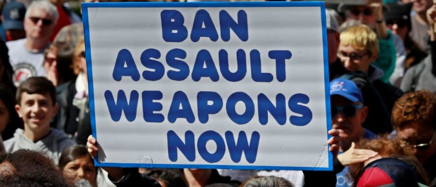 """A protestor holds a sign during a """"March For Our Lives"""" demonstration demanding gun control in Sacramento, California, U.S. March 24, 2018. REUTERS/Bob Strong 