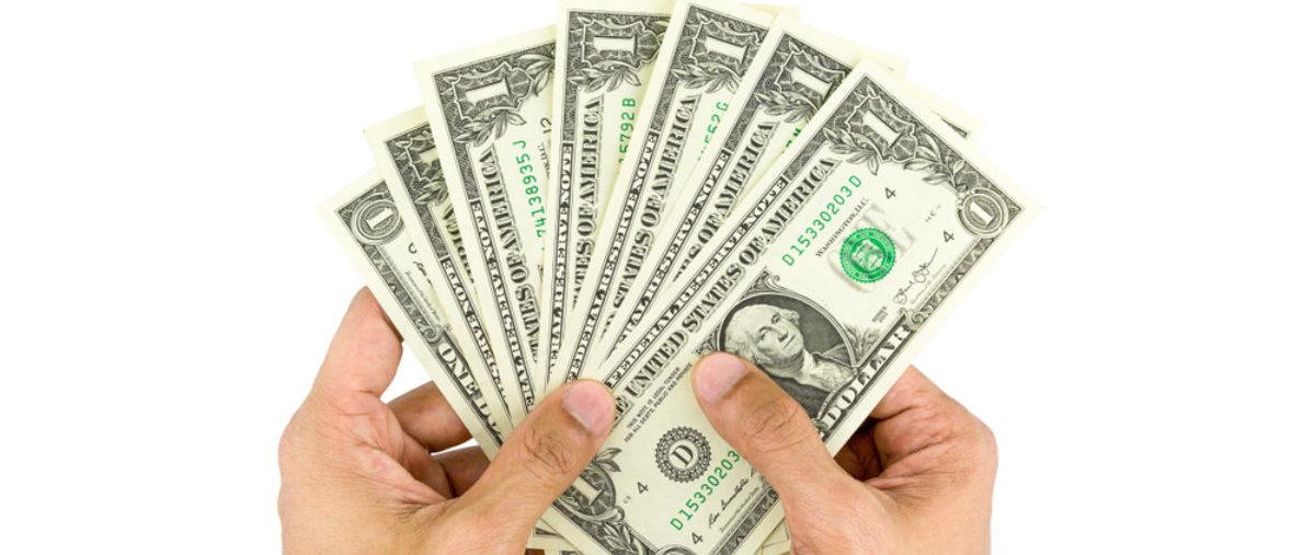 Hands Hold Dollar Bills e