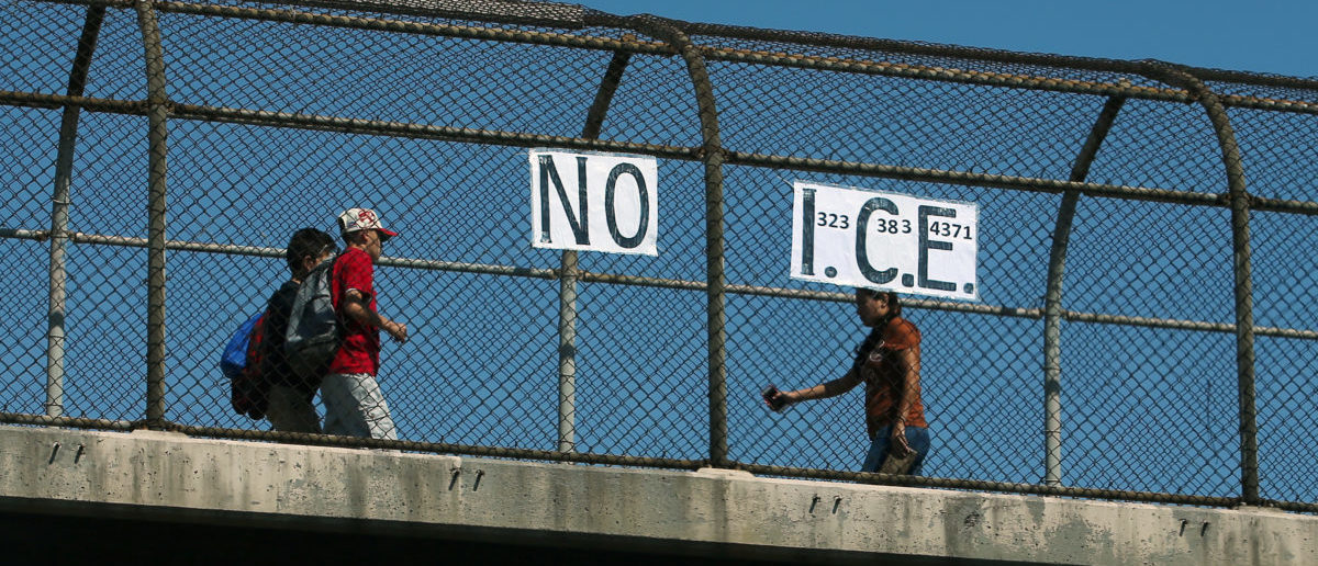 Los Angeles resident Jack Gerritsen ,81, has been making a political comment since the election of President Donald Trump by placing NO I.C.E. (U.S. Immigration and Customs Enforcement) signs throughout the city, this one on a pedestrian overpass crossing a freeway in Los Angeles, California, U.S. April 18, 2017. REUTERS/Mike Blake