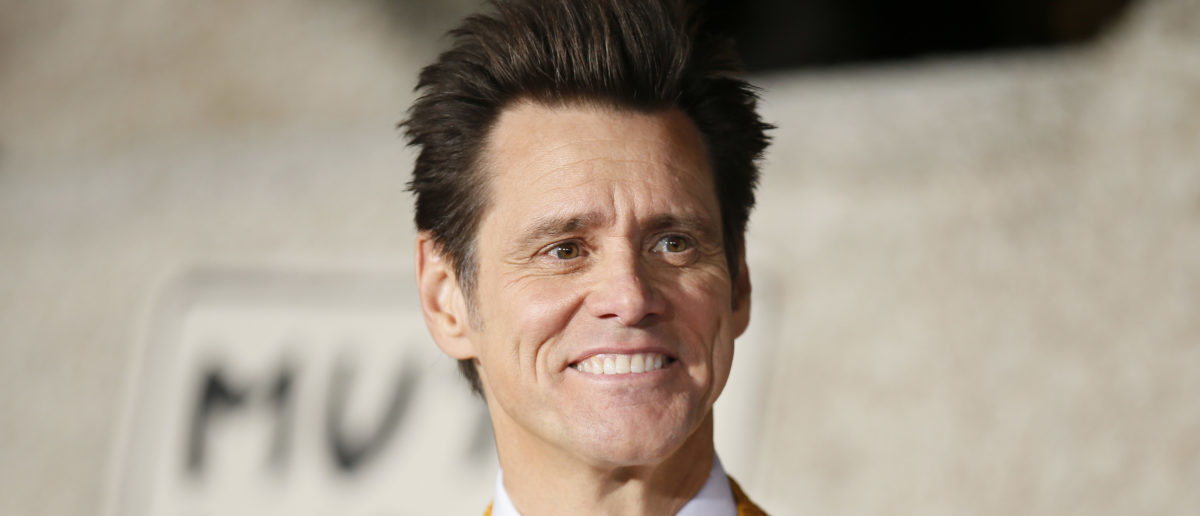 "Actor Jim Carrey poses at the world premiere of the film ""Dumb and Dumber To"" in Los Angeles, November 3, 2014. REUTERS/Danny Moloshok"