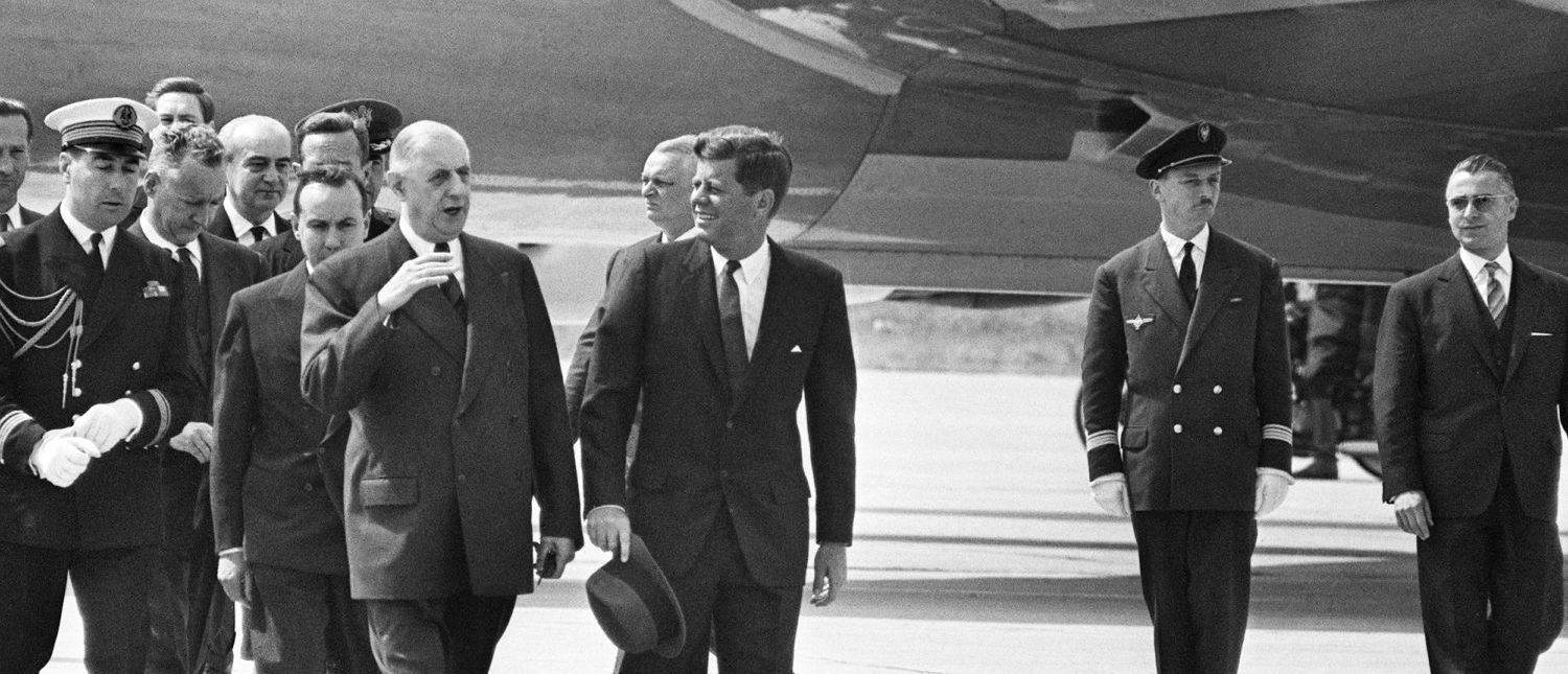 US President John Fitzgerald Kennedy (C, 1917-63) is welcomed 31 May 1961 at Paris Orly airport by French President General Charles de Gaulle (L) and his Prime Minister Michel Debré (behind de Gaulle). 09 November 1960, Kennedy was the first Catholic, and the youngest person, to be elected for Democratic party the president of the USA. 22 November 1963, Kennedy was assassinated while being driven in an open car through Dallas. (Photo: AFP/Getty Images)