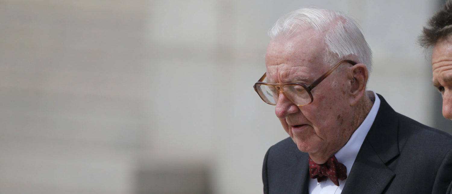Retired U.S. Supreme Court Justice John Paul Stevens departs the funeral of U.S. Supreme Court Associate Justice Antonin Scalia at the Basilica of the National Shrine of the Immaculate Conception in Washington, February 20, 2016. REUTERS/Carlos Barria