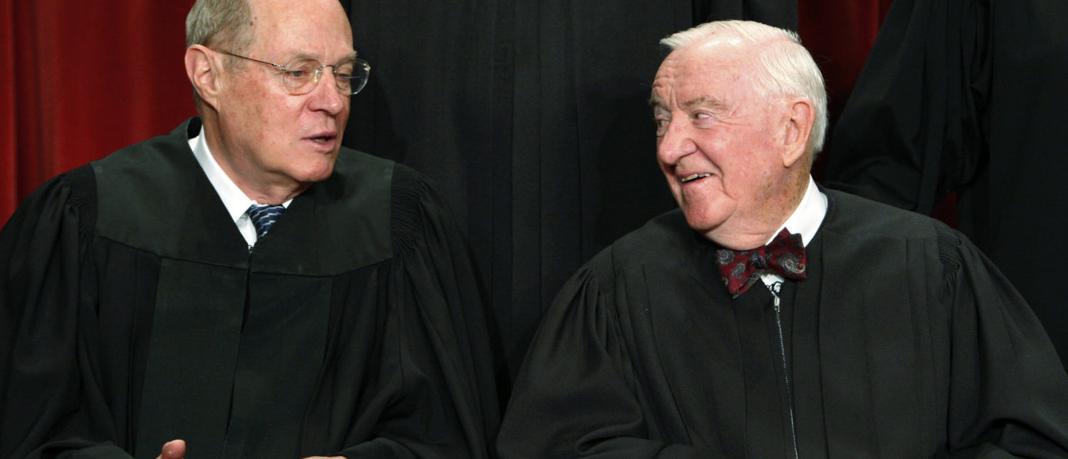 U.S. Supreme Court Justice Anthony M. Kennedy (L) speaks with Justice John Paul Stevens during their official photograph with the other Justices at the Supreme Court in Washington September 29, 2009. REUTERS/Jim Young