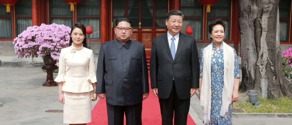 North Korean leader Kim Jong Un and wife Ri Sol Ju, and Chinese President Xi Jinping and wife Peng Liyuan pose for a photo in Beijing, China, in this undated photo released by North Korea's Korean Central News Agency (KCNA) in Pyongyang March 28, 2018. KCNA/via Reuters