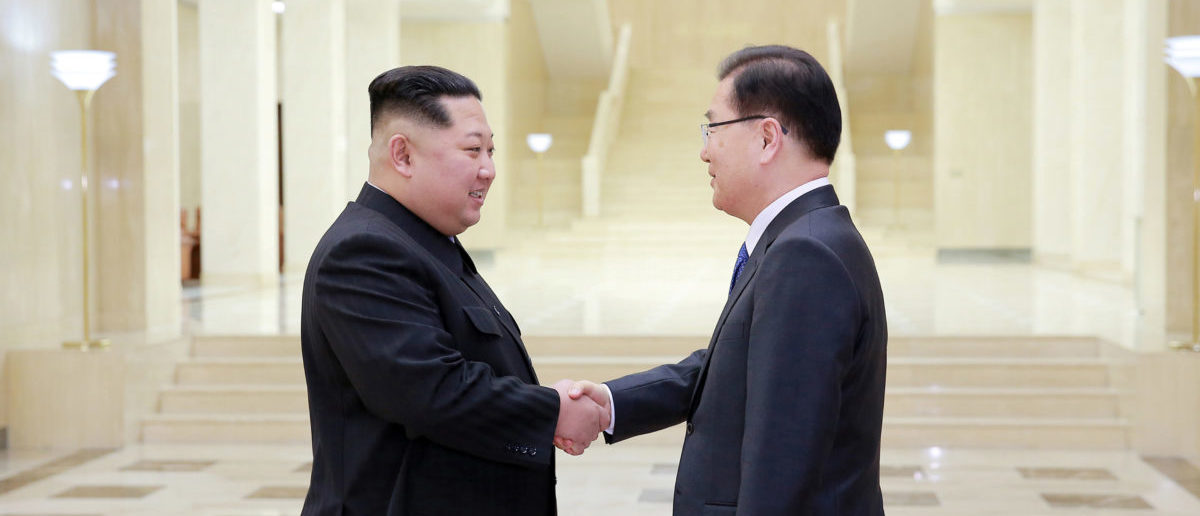North Korean leader Kim Jong Un shakes hands with Chung Eui-yong who is leading a special delegation of South Korea's President, in this photo released by North Korea's Korean Central News Agency (KCNA) on March 6, 2018. KCNA/via Reuters