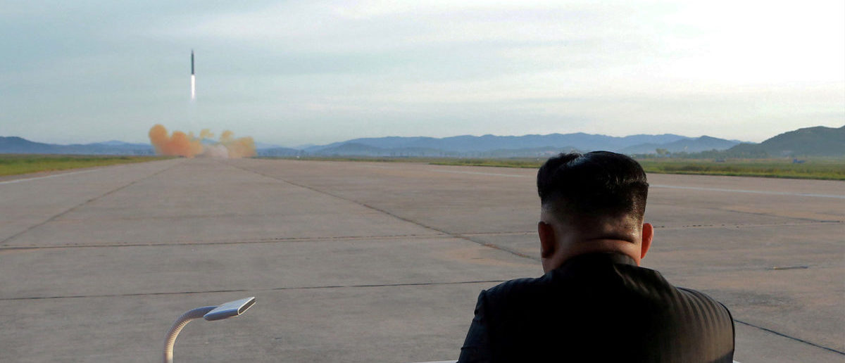North Korean leader Kim Jong Un watches the launch of a Hwasong-12 missile in this undated photo released by North Korea's Korean Central News Agency (KCNA) on September 16, 2017. KCNA via REUTERS/File Photo