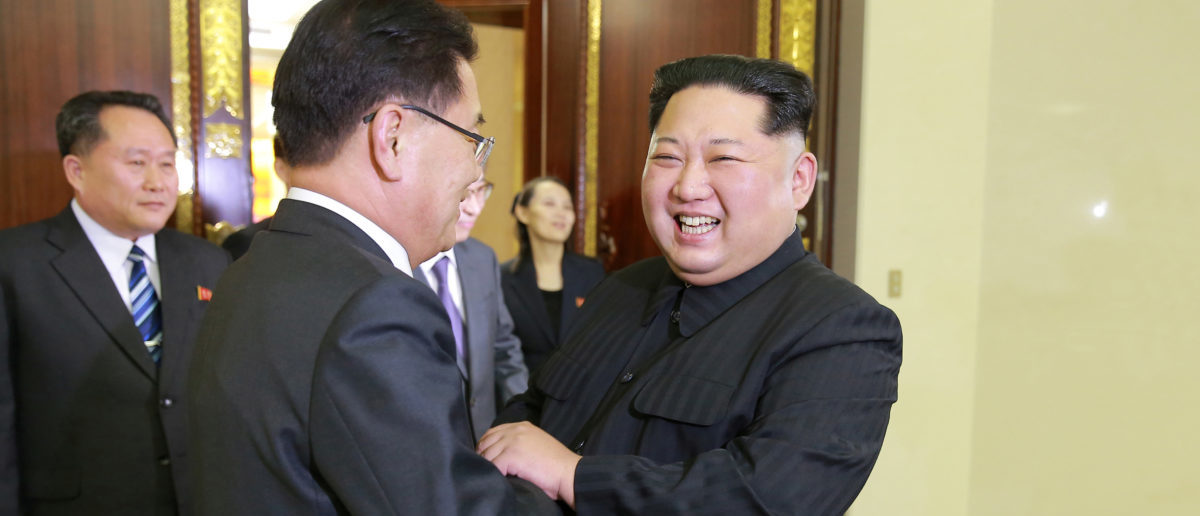 North Korean leader Kim Jong Un greets a member of the special delegation of South Korea's President at a dinner in this photo released by North Korea's Korean Central News Agency (KCNA) on March 6, 2018. KCNA/via Reuters