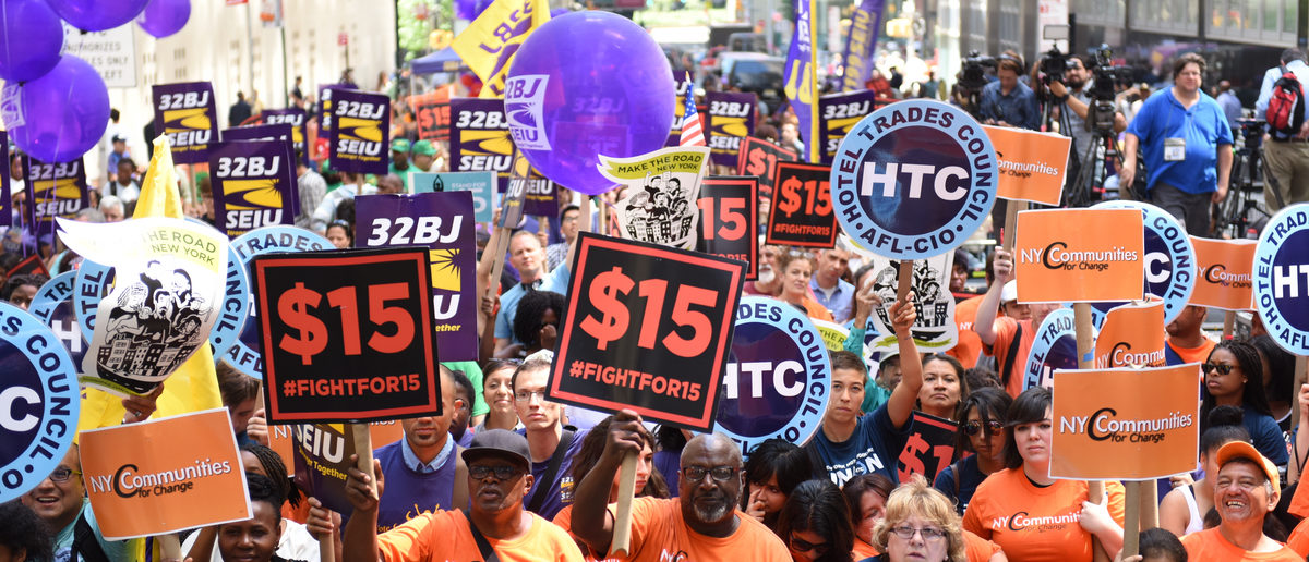 Organized labor, fast food workers & elected officials gathered on Barclay St. to celebrate the NY wage board's recommendation for a $15/hr minimum wage statewide by 2021. (Shutterstock/a katz)