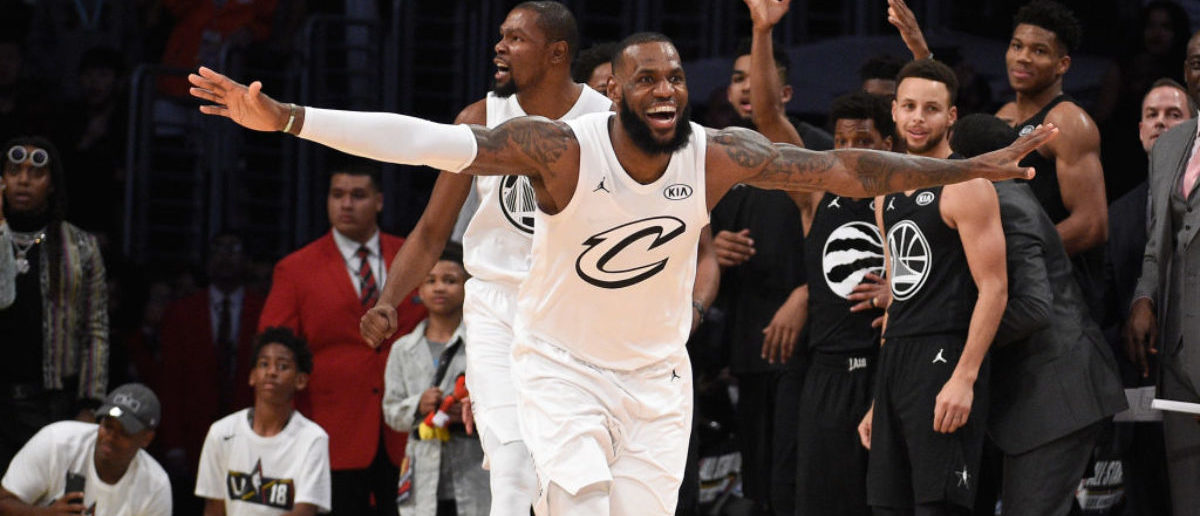 LOS ANGELES, CA - FEBRUARY 18: LeBron James #23 of Team LeBron celebrates as Stephen Curry #30 of Team Stephen looks on after the end of the NBA All-Star Game 2018 at Staples Center on February 18, 2018 in Los Angeles, California. (Photo by Kevork Djansezian/Getty Images)